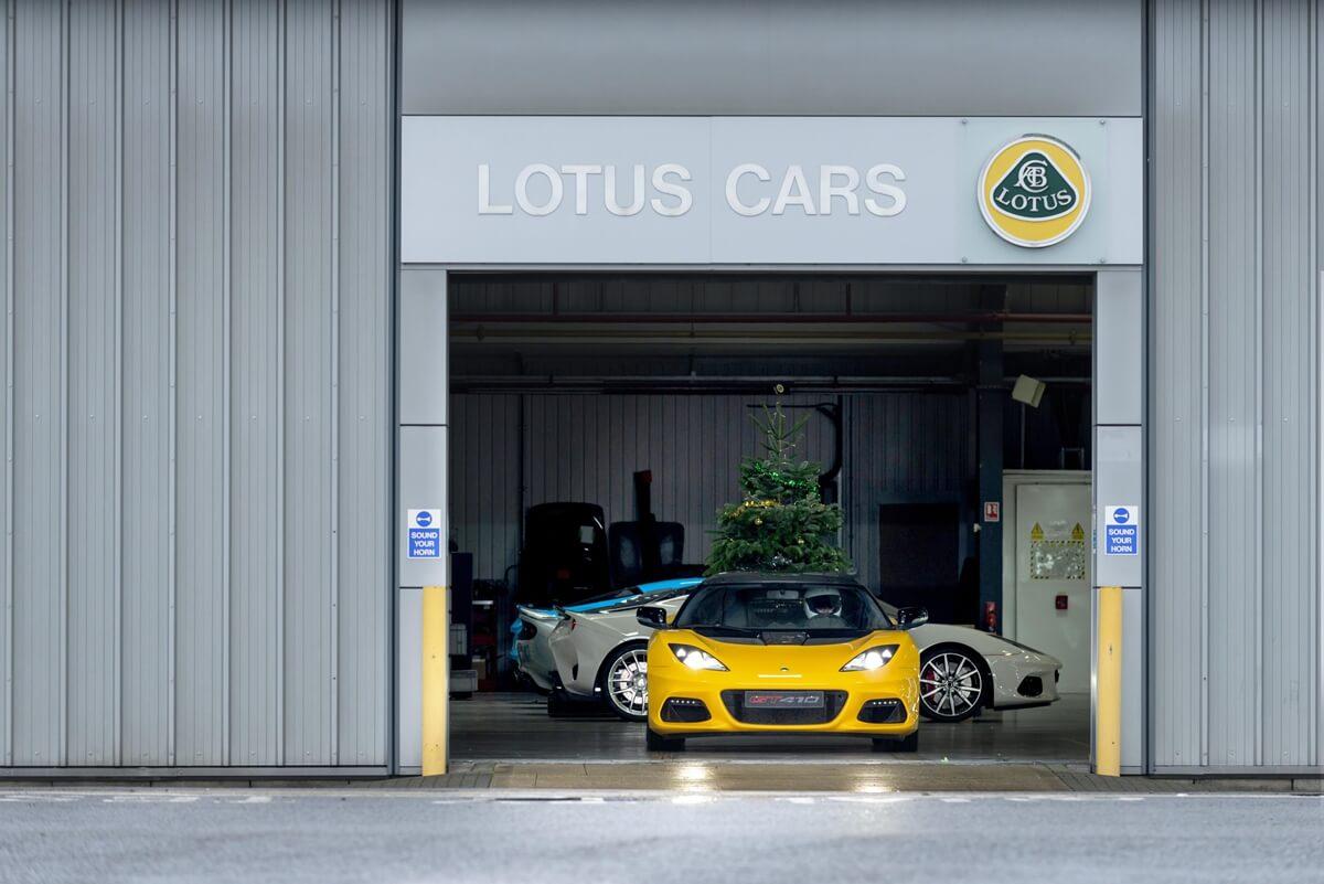 DriftmasEvora Lotus GT410 Sport lines up outside HandmadeinHethel factory before burning off sideways for MerryDriftmas video.jpg