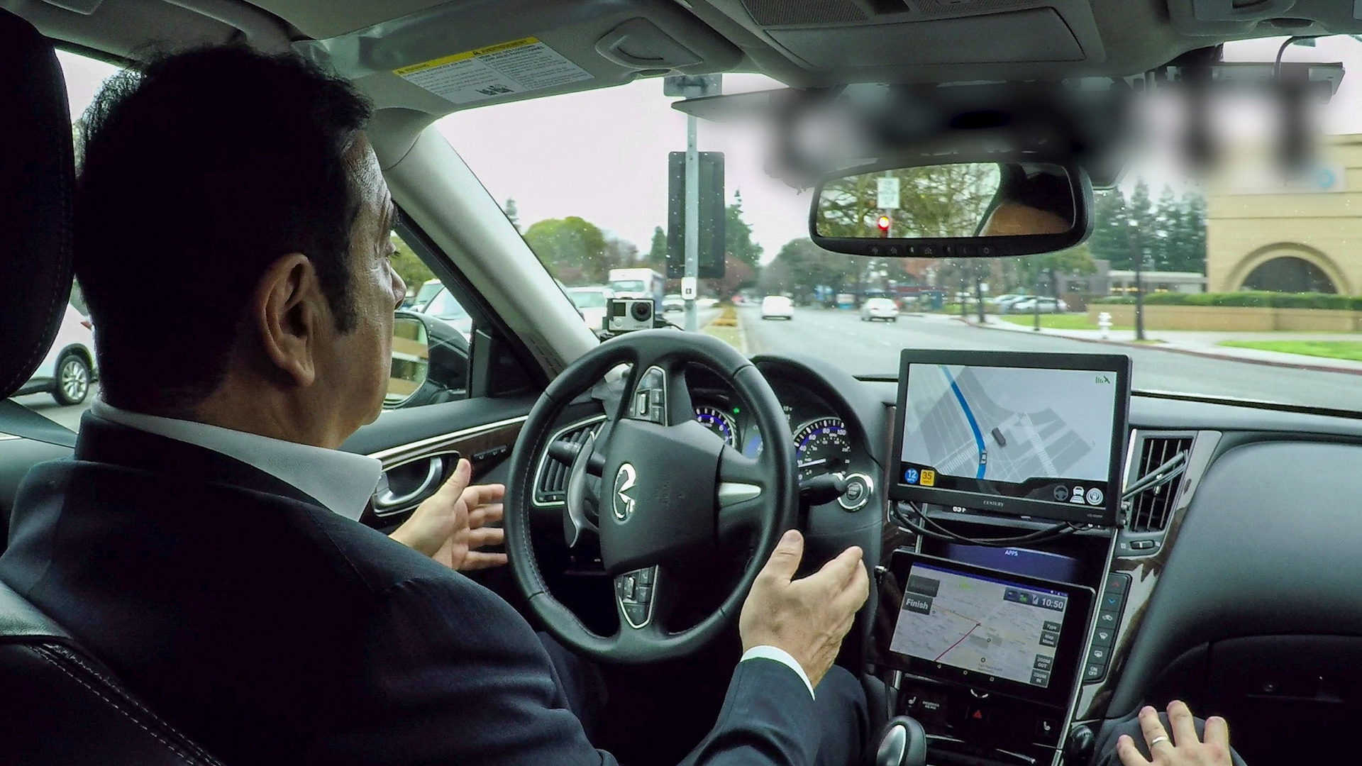 carlos-ghosn-drives-infiniti-q50-autonomous-prototype.jpg